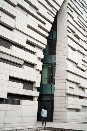 Woman walking on building in city