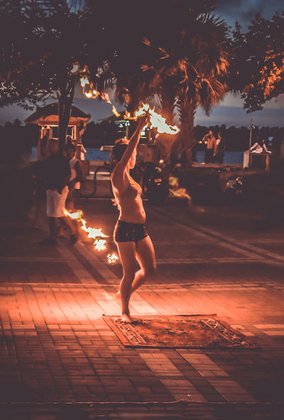 EyeEmNewHere Key West At Night Dancing Enjoyment Full Length Illuminated Leisure Activity Lifestyles Men Motion Nature Night One Person Outdoors People Performance Real People Skill  Sky Sunset Tree Women Young Adult
