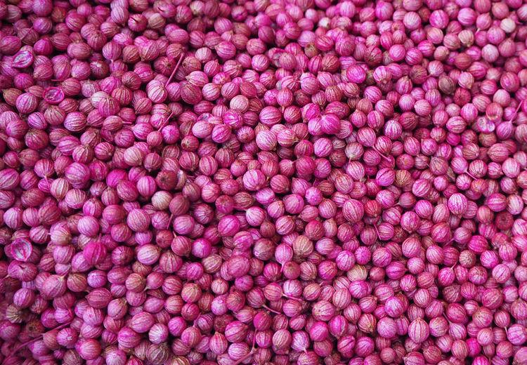 Full Frame Shot Of Pink Coriander Seeds For Sale At Market