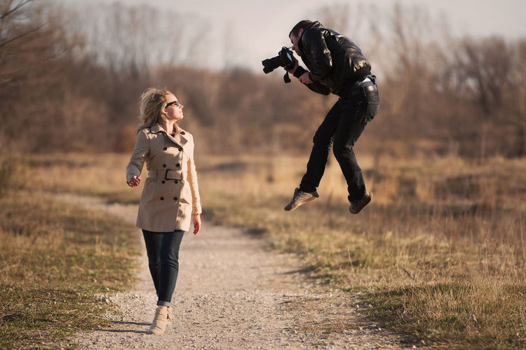 What a photographer's relationship looks like. Full Length Leisure Activity Women Young Women Running Lifestyles Nature Young Adult People Land Day Field Real People Focus On Foreground Adult Grass Clothing Motion Outdoors Warm Clothing Model Photography Jumping Funny