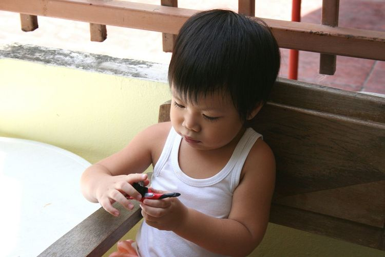 Close-up of boy playing with toy at home