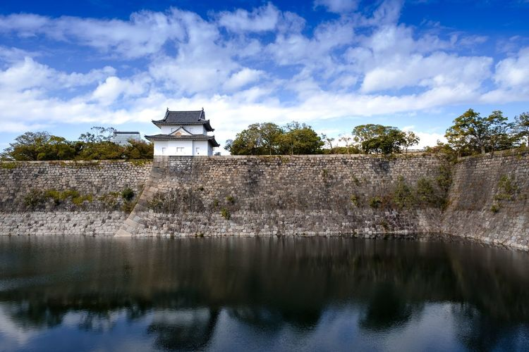 Small castle at the wall and lake beside Osaka castle with blue sky and water reflection Built Structure Architecture Water Building Exterior Sky Building Cloud - Sky Plant Nature Tree No People Day Reflection Waterfront Lake Outdoors OSAKA Osaka,Japan Osaka-shi,Japan Osaka Castle Water Reflections Reflections In The Water Castle Japan Photography Japan
