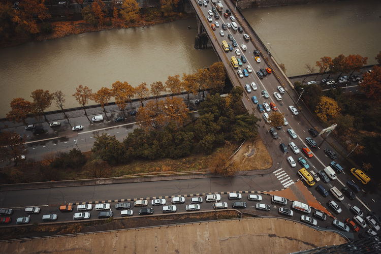Transportation Motor Vehicle Road Car Mode Of Transportation High Angle View Architecture Tree Land Vehicle City Built Structure Street Nature Water Plant Connection No People Bridge Traffic Bridge - Man Made Structure Outdoors Multiple Lane Highway