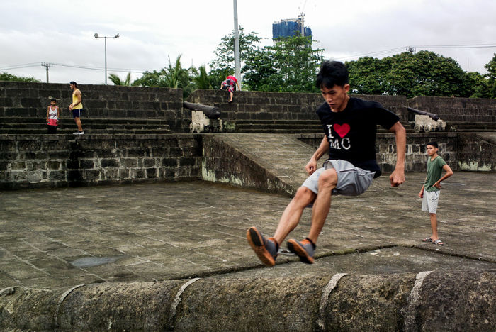 Only Men Leisure Activity Full Length Adults Only Adult Sport People Playing Lifestyles Togetherness Young Adult Men Two People Baseball - Sport Built Structure Day Friendship Sitting Outdoors City Streetphotography EyeEmMagazine Eyeem Marketplace Eyeem Philippines Layering