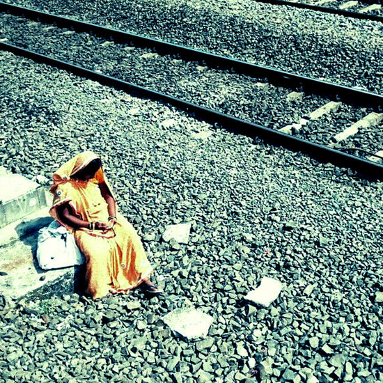 Alone Day High Angle View Lady Lonely Outdoors Railway Tracks Stones Sunny Day Tracks Train Travel Waiting Woman Yellow Saa Break The Mold The Street Photographer - 2017 EyeEm Awards BYOPaper! Paint The Town Yellow