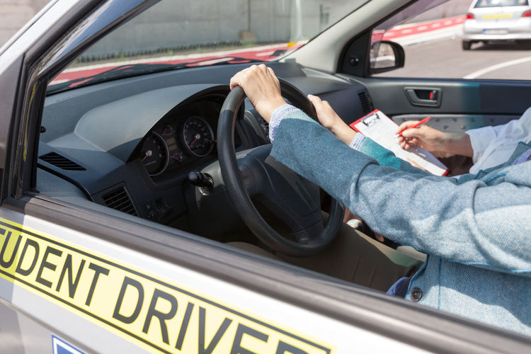 Midsection of woman learning driving
