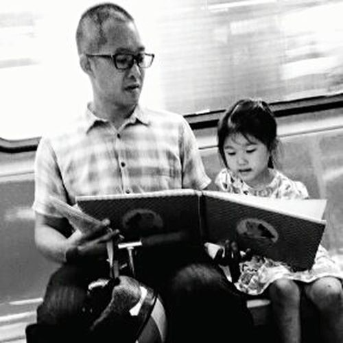 Reading time on the subway. Snap A Stranger Reading A Book Child Father And Daughter Asian Girl Child Reading