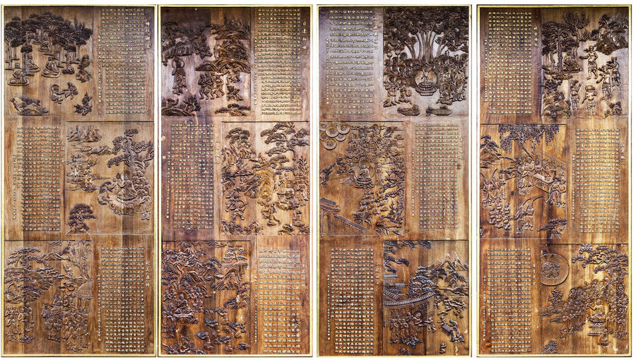 Buddhist story and Engraving art Ancient Architecture Architecture Buddhist Story Calligraphy Detailed Doors Engraving Exquisite Beauty Famous Tourist Destinations Fine Full Frame Temple The Nan-PuTuo Temple Xiamen China Close-up Close-up Shot Delicate Detail Engraving Art Exquisite Full Frame Ornate Ornate Door