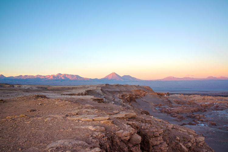 Scenic view of atacama desert against clear sky during sunset