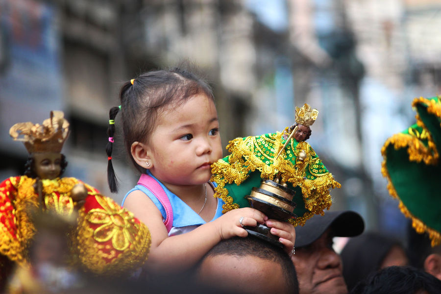 This young kid is one of the faithful devotees to Sto. Niño. Sinulog Sinulog Festival Traditional Traditional Culture Traditional Festival The Week on EyeEm The Week Of Eyeem EyeEmNewHere Childhood Cute Child Baby One Person Babies Only Happiness People Smiling Social Issues Outdoors Portrait Real People Day Adult Close-up Visual Creativity