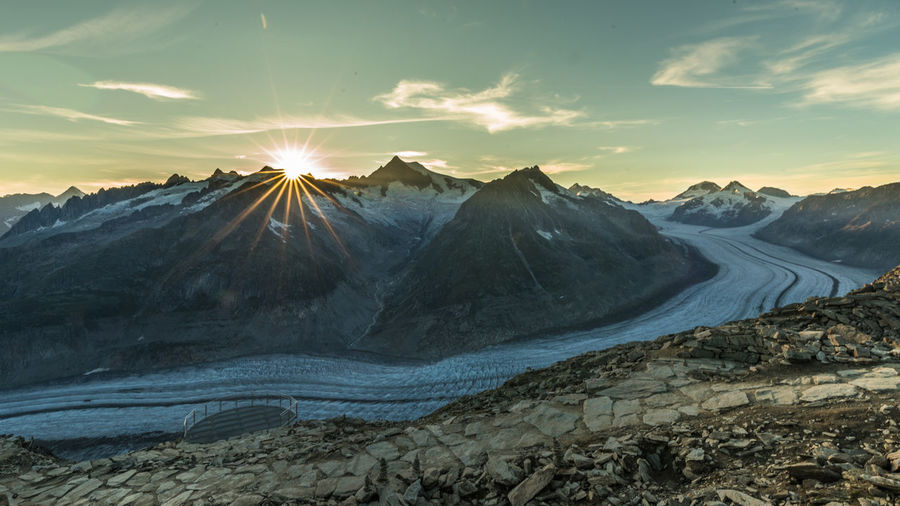 Mighty Aletsch glacier Beauty In Nature Bright Cloud - Sky Environment Formation Glacier Idyllic Landscape Mountain Mountain Peak Mountain Range Nature No People Non-urban Scene Outdoors Remote Scenics - Nature Sky Sun Sunbeam Sunlight Sunset Switzerland Tranquil Scene Tranquility