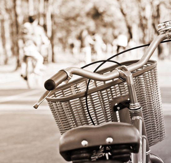 Close-up of bicycle in basket on street