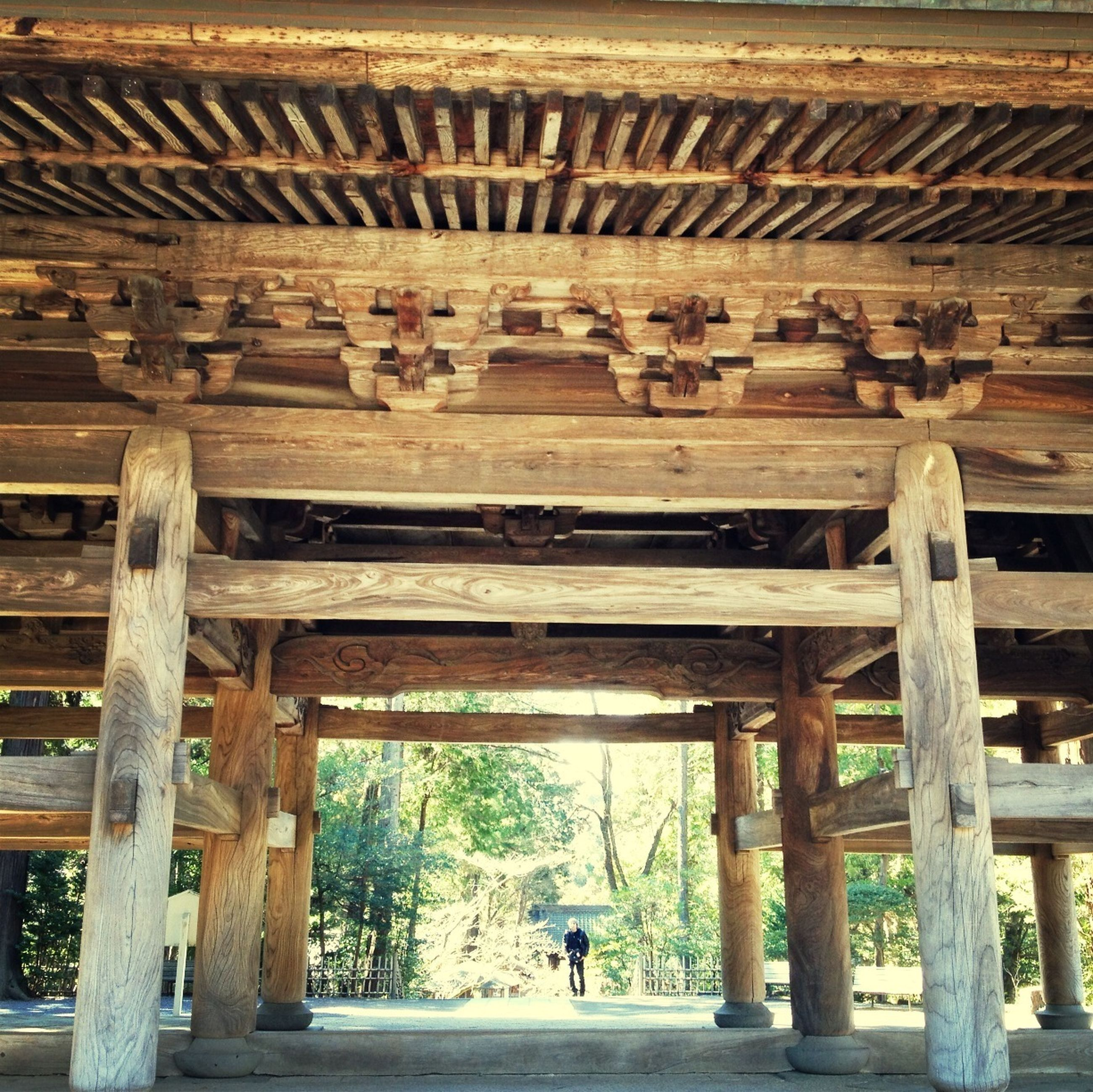 built structure, men, architecture, lifestyles, person, leisure activity, full length, architectural column, wood - material, walking, rear view, water, indoors, travel, pier, arch, tourist