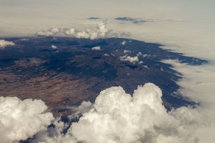 Aerial view of sea against cloudy sky