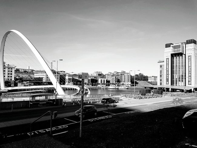 Home.❤👌 Travel Home Photography Building Quayside Newcastle Upon Tyne River Tyne, Society Blackandwhite Architecture Building Exterior Built Structure City Water Transportation River Clear Sky Blue Travel Travel Destinations City Life Waterfront Sky Day Skyscraper