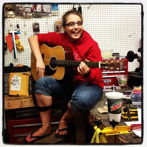 Chantel showing her Country side. Guitar Outbackarchery music