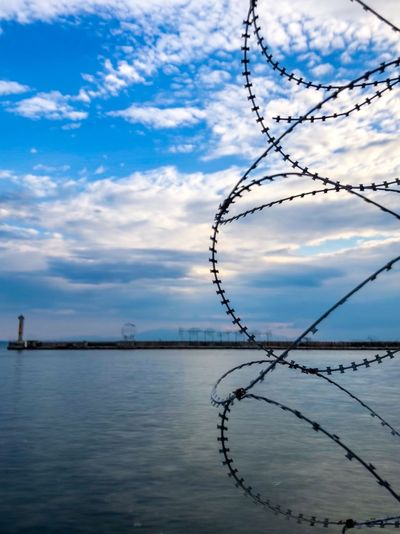Small circle fences near a sea in a port,in a Greek town Thessaloniki Summer Tourism View Europe Port Greece Ocean Seascape Fences Thessaloniki Greece
