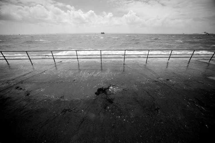 Not So Distant Sea Sea Water Sky Horizon Horizon Over Water Scenics - Nature Cloud - Sky Nature Beauty In Nature Railing Day Outdoors Waterfront Blackandwhite Black And White