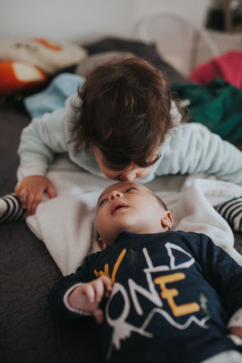 Sister kissing young brother