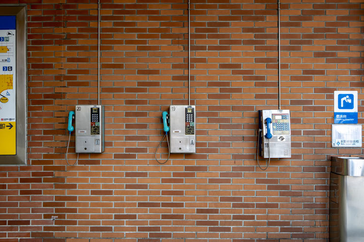 quiet corner of local telephone machine become vintage items for wall decorate Meter - Instrument Of Measurement Electrical Component Power Supply Fuse Box Outdoors Building Exterior Architecture Electricity  Vintage Style Telephone Booth