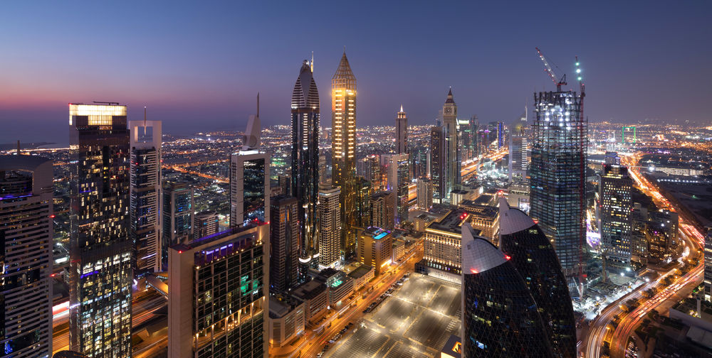 The beautiful cityscape of Dubai Downtown after sunset Building Exterior City Architecture Built Structure Illuminated Office Building Exterior Building Skyscraper Cityscape Night Modern Tower Urban Skyline Landscape Sky Office Tall - High City Life Travel Destinations Residential District City Street Financial District  No People Outdoors Dubai