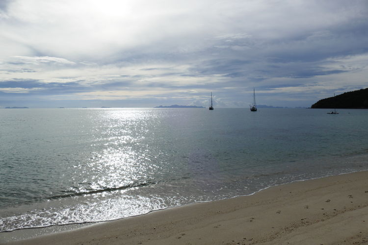 Sea Water Sky Beach Horizon Cloud - Sky Horizon Over Water Land Beauty In Nature Idyllic Scenics - Nature Day Nature Tranquil Scene Sand No People Outdoors Tranquility Moody Sky Sailling Boats Dramatic Sky Seaside Seascape Skyscape Sea And Sky Travel Destinations