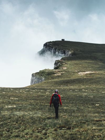 Woman Adventure Backpack Beauty In Nature Day Fog Full Length Hiking Landscape Leisure Activity Lifestyles Men Mist Mountain Nature One Person Outdoors Real People Rear View Rock - Object Scenics Standing Tourism Travel Vacations Lost In The Landscape Perspectives On Nature