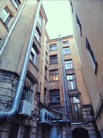 Russia, St.Petersburg Courtyard Of St. Peter Old Town Urban Courtyard  Trash Windows Grunge Trumpet Yard-well