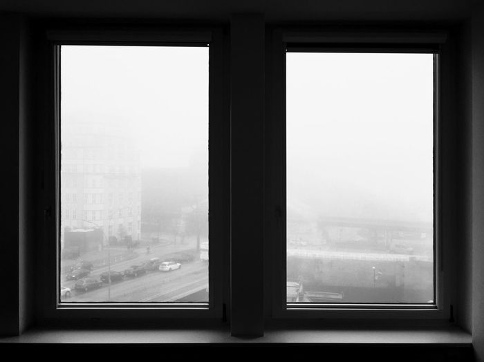 City During Foggy Weather Seen From Window