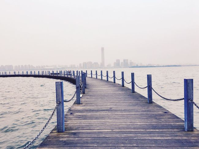 Road Sea Water Railing Pier Clear Sky Outdoors Wooden Post Built Structure Architecture Beach Sky Day Nature Scenics No People Horizon Over Water Beauty In Nature