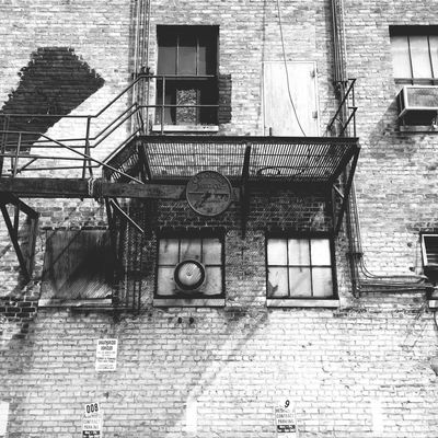 Architecture Window Building Exterior Built Structure Wall - Building Feature Balcony Day Outdoors No People City Life Façade Exterior Brick Wall Alley Minnesotaphotographer Urbanphotography Streetphotography