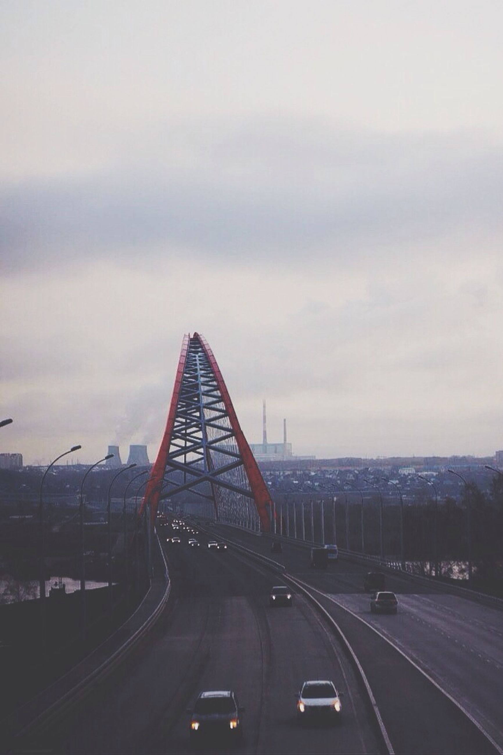 transportation, road, car, sky, land vehicle, built structure, architecture, road marking, the way forward, mode of transport, bridge - man made structure, cloud - sky, connection, street, city, highway, cloudy, on the move, diminishing perspective, vanishing point