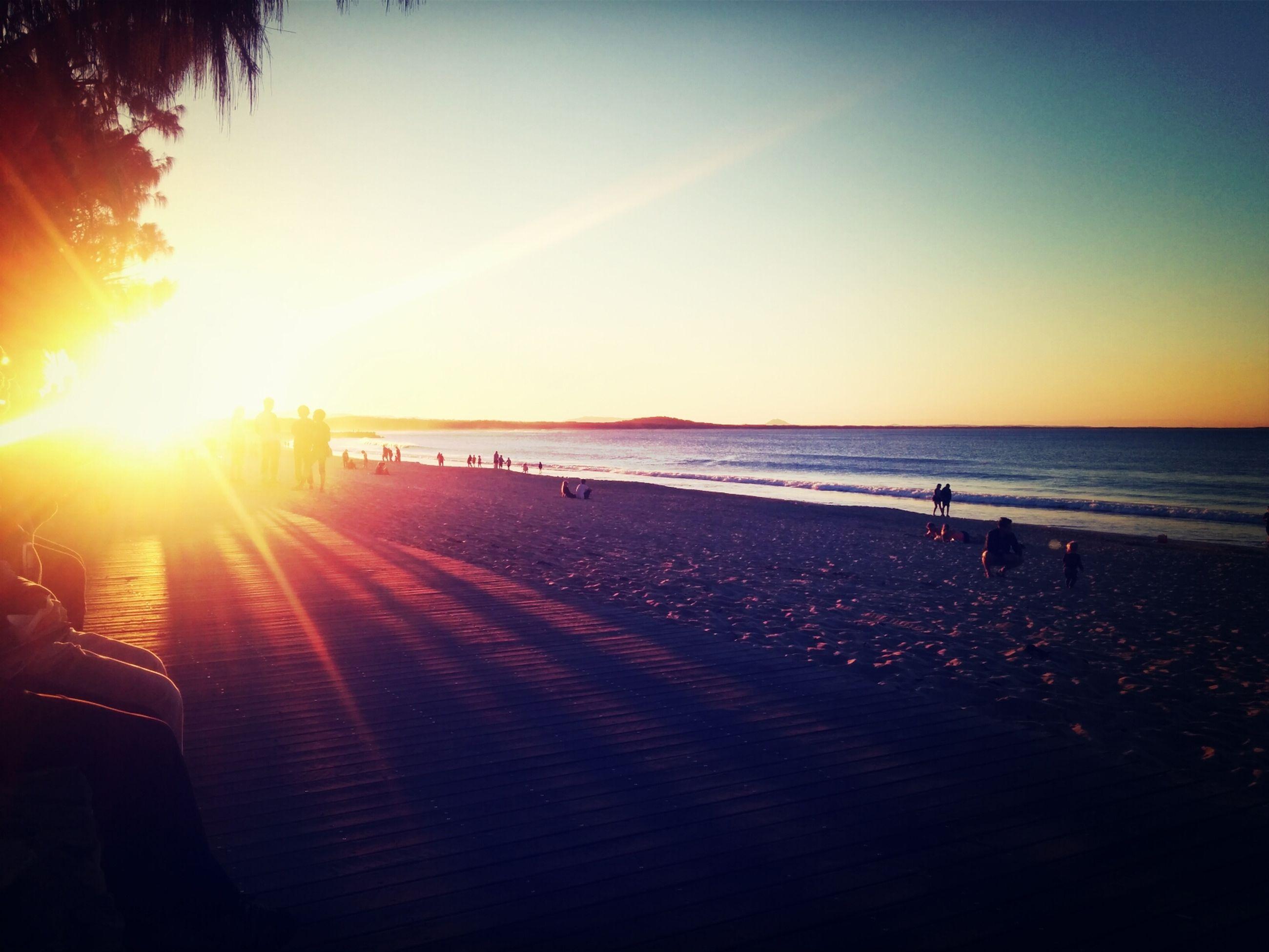 sun, sea, sunset, horizon over water, beach, water, sunlight, sunbeam, scenics, shore, beauty in nature, tranquil scene, lens flare, tranquility, sand, sky, orange color, nature, clear sky, idyllic