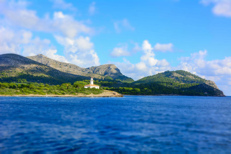EyeEmNewHere Lighthouse Lifesaver Seaview Miniature Mountains And Sea Mountains And Lighthouse Hills And Valleys Lighthouse In The Distance Mallorca Spaın Vibrant Cruiship Memory Travel Photography Swimming Pirates Show The Way