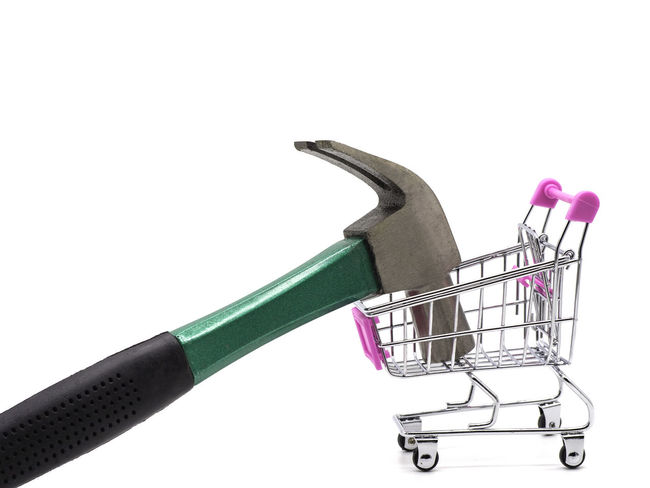 Hammer and shopping cart isolated on white background. Studio Shot White Background Shopping Cart Indoors  Copy Space Close-up Metal No People Shopping Cut Out Still Life Consumerism Single Object Store Equipment Work Tool Hand Tool Retail  Tool Supermarket