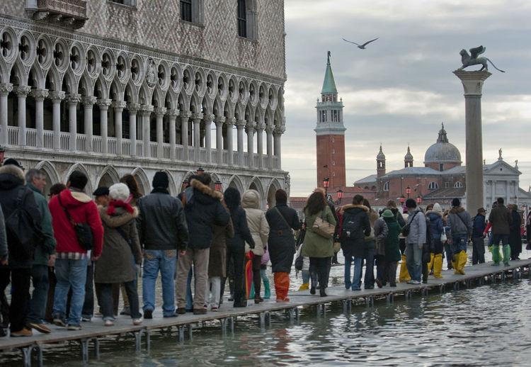 Tourist visiting saint mark basilica against sky