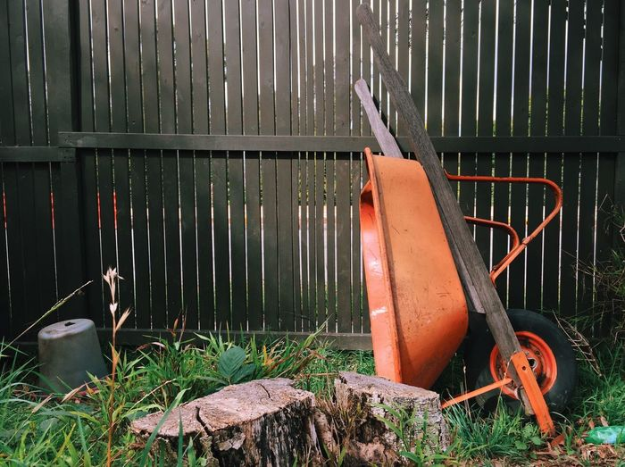 Still Life with Red Wheelbarrow Abandoned Absence Chair Damaged Day Deterioration Empty Field Garden Metal Metallic No People Obsolete Old Outdoors Protection Red Red Run-down Rusty Safety Still Life Wheelbarrow Wood - Material