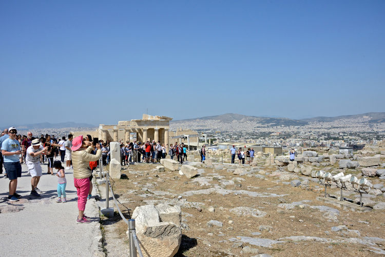 crowd in the Acropolis among the ruins and cityscape of Athens Group Of People Crowd Large Group Of People Real People Travel Destinations Architecture Travel Tourism Tourist Sky Day History Built Structure Clear Sky Leisure Activity Men Women Nature Copy Space Outdoors Ancient Civilization Archaeology Athens, Greece Acropolis, Athens Ruins Architecture Urban Skyline Cityscape Tourists Tourist Attraction  Greek Archeological