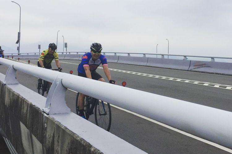 Bikers. Bicycle Bikes Bikers Real People Water Sky Railing Group Of People
