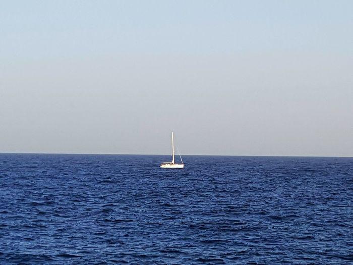 Nautical Vessel Sailing Sea Water Sailboat Transportation Sailing Ship Horizon Over Water Outdoors Sky Yachting Yacht White Sailing Ship One Single Sailboat Sailing Boat Blue Sea And White Sailboat
