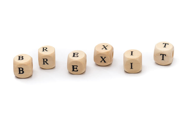 Alphabet Brexit Capital Letter Communication Cube Shape Cut Out Dice Group Of Objects Indoors  Letter Medium Group Of Objects No People Spelling Still Life Studio Shot Text Toy Toy Block Western Script White Background Wood - Material