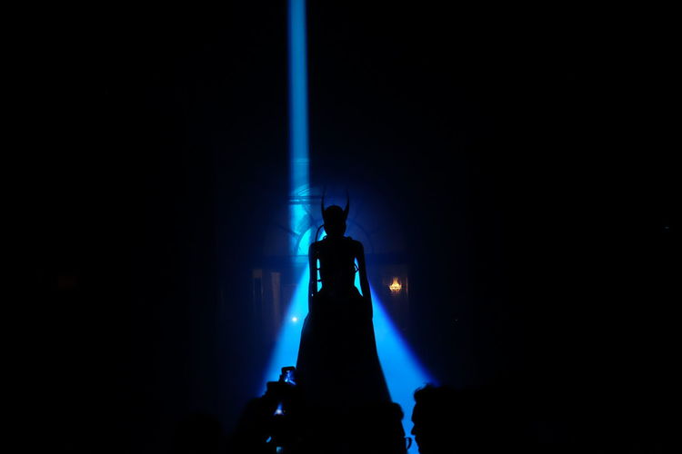 The Los Angeles Statue Silhouette Night Sculpture Illuminated Standing Crown Indoors  People Politics And Government Young Adult Downtown Straightfromcamera Low Angle View Modern Ghost Streetphotography Architecture Indoors  Downtown District City Theater District Blue Pointy Cityscape