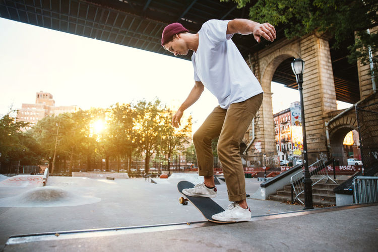 Man skateboarding on skateboard in city