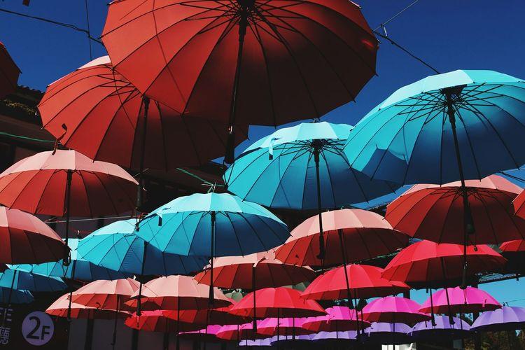 Multi colored umbrellas against clear sky