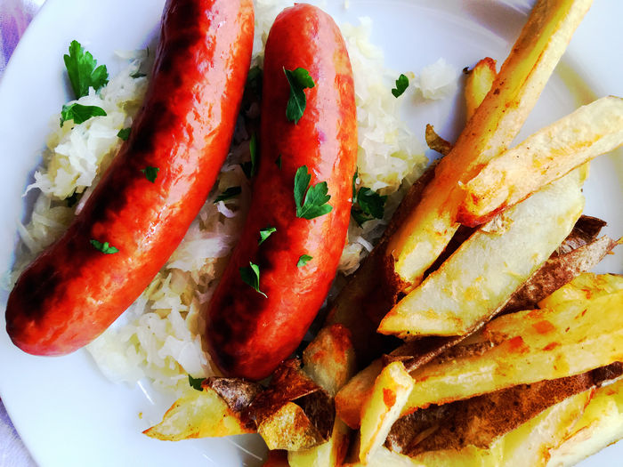 Sausages with fries and sauerkraut Cilantro Close-up Cooked Dinner Food Freshness Fried Potatoes Fries Hearty Food Indoors  Lunch Meal Meat Overhead Phone Camera Plate Ready-to-eat Sauerkraut Sausages Supper Vegetable