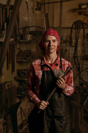 Portrait of blacksmith at workshop