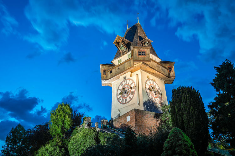 Schlossberg Clock Tower in Graz Cityscape Skyline Twilight Architecture Bell Tower Blue Building Exterior Built Structure Clock Clock Tower Cloud - Sky Day Low Angle View Nature Night No People Outdoors Schlossberg Schlossberg Graz Sculpture Sky Statue Sunset Tower Tree Twilight Sky