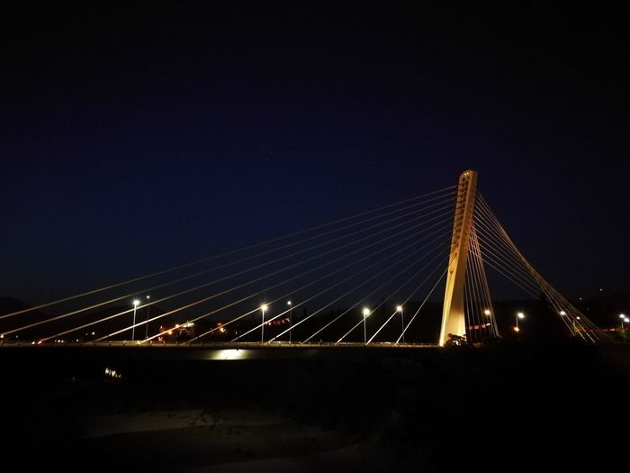 Night Bridge - Man Made Structure Suspension Bridge Connection Architecture Illuminated Sky Outdoors Light Trail No People Skyscraper Cityscape Water Clear Sky Travel Destinations City Built Structure Transportation Long Exposure Podgorica, Montenegro Montenegro First Eyeem Photo The Architect - 2017 EyeEm Awards