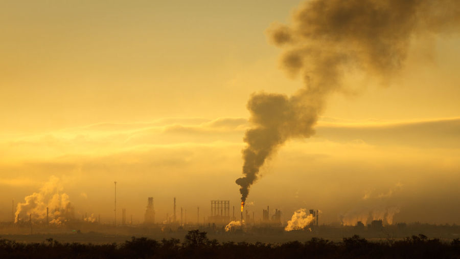 Air Pollution Architecture Day Emitting Environment Environmental Issues Factory Fumes Global Warming Industry Nature Outdoors Pollution Sky Smoke - Physical Structure Smoke Stack Sunset