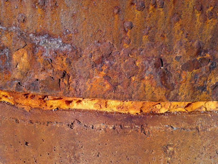 Rusted surface Textured  Yellow Close-up Marine Oxide Yellow Strip Browny